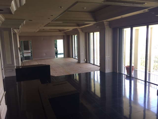 Living area with black flooring at the Jockey Club Penthouse for sale.