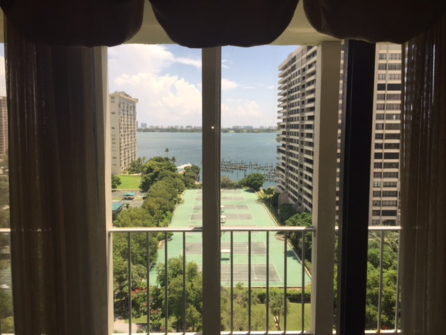 View of tennis courts and bay from bedroom at the Jockey Club Penthouse for sale.